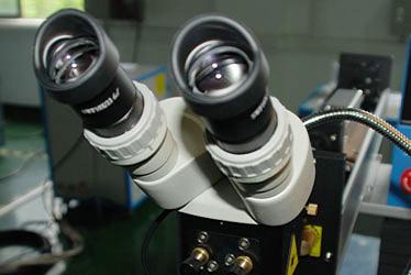 18luck激光ping行光路显wei镜